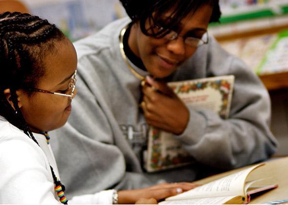 Black teacher and student.