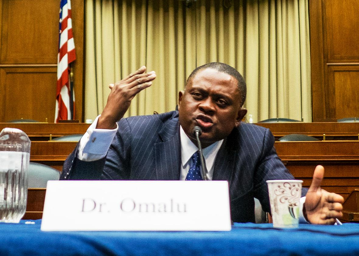 Forensic pathologist and neuropathologist Dr. Bennet Omalu participates in a briefing sponsored by Rep. Jackie Speier on Capitol Hill on January 12, 2016 in Washington, DC.