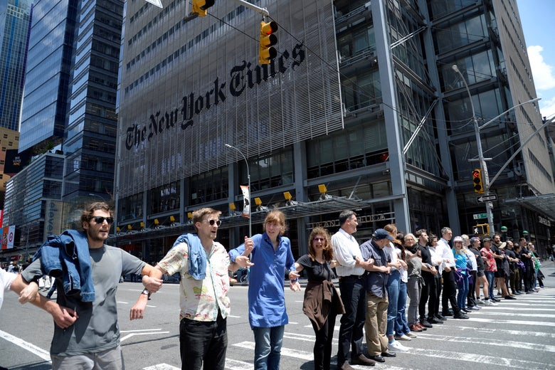 Activists from the group Extinction Rebellion block traffic on 8th Avenue in front of the New York Times building and the Port Authority Bus Terminal near Times Square in New York City on June 22, 2019.
