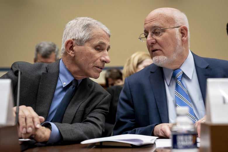 Anthony Fauci talks with Robert Redfield.