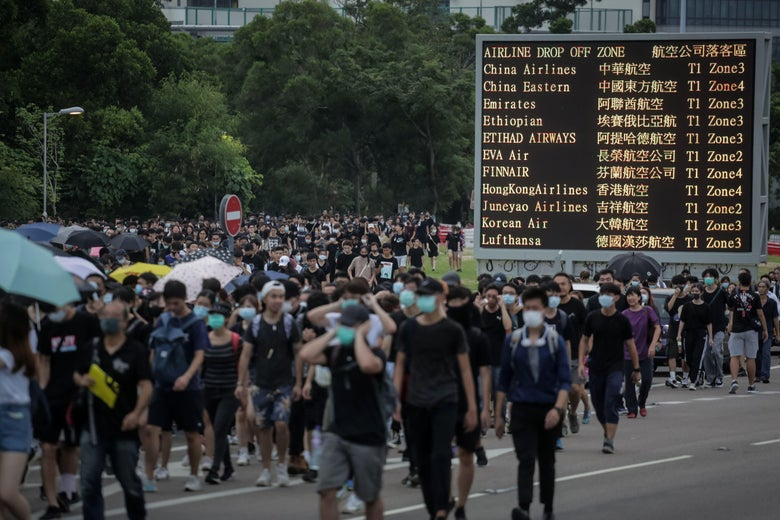 Protesters walk on a highway near Hong Kong's international airport.
