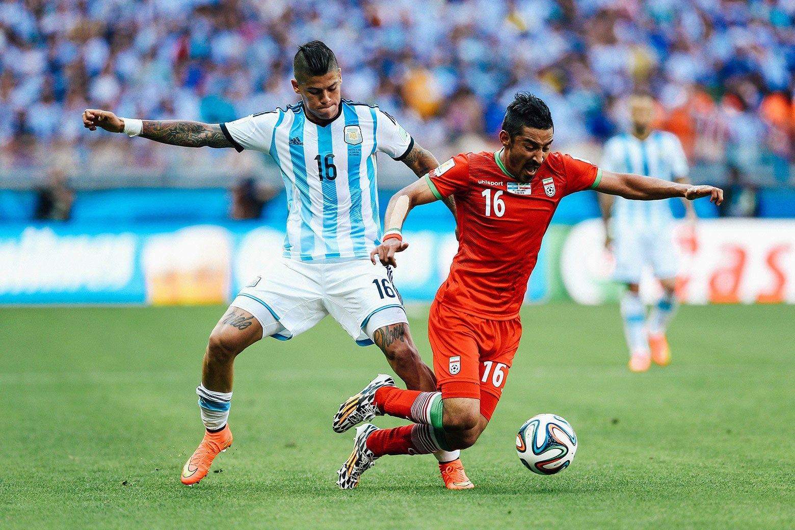 "Marcos Rojo's ""pride"" and ""glory"" tattoos are seen on his thighs as he challenges another player for the ball."