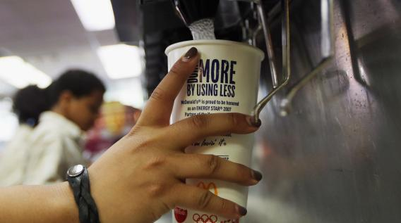 A customer fills a 21 ounce cup with soda at a 'McDonalds'.