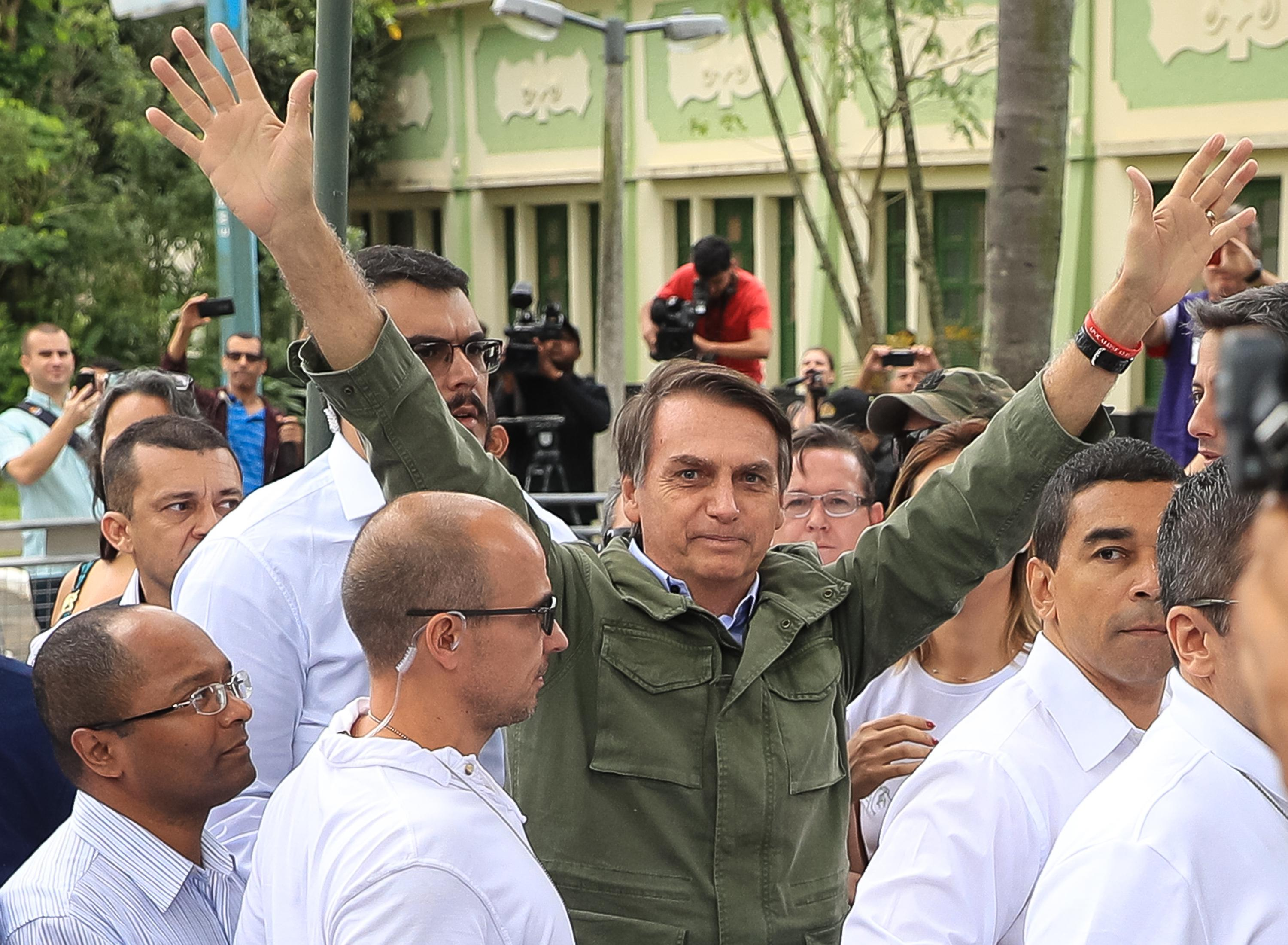 Jair Bolsonaro gestures after casting his vote during general elections on October 28, 2018 in Rio de Janeiro, Brazil.