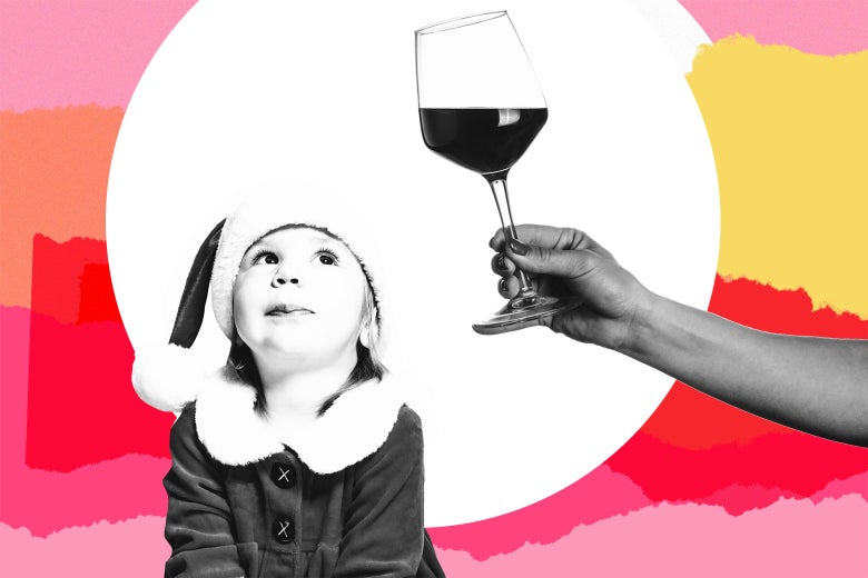Child wearing a holiday hat looks at a disembodied hand holding a glass of what appears to be red wine.