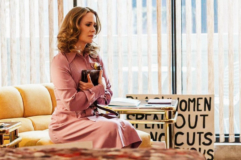 Sarah Paulson as Alice sitting on a sofa, clutching a book to her chest, looking conflicted.