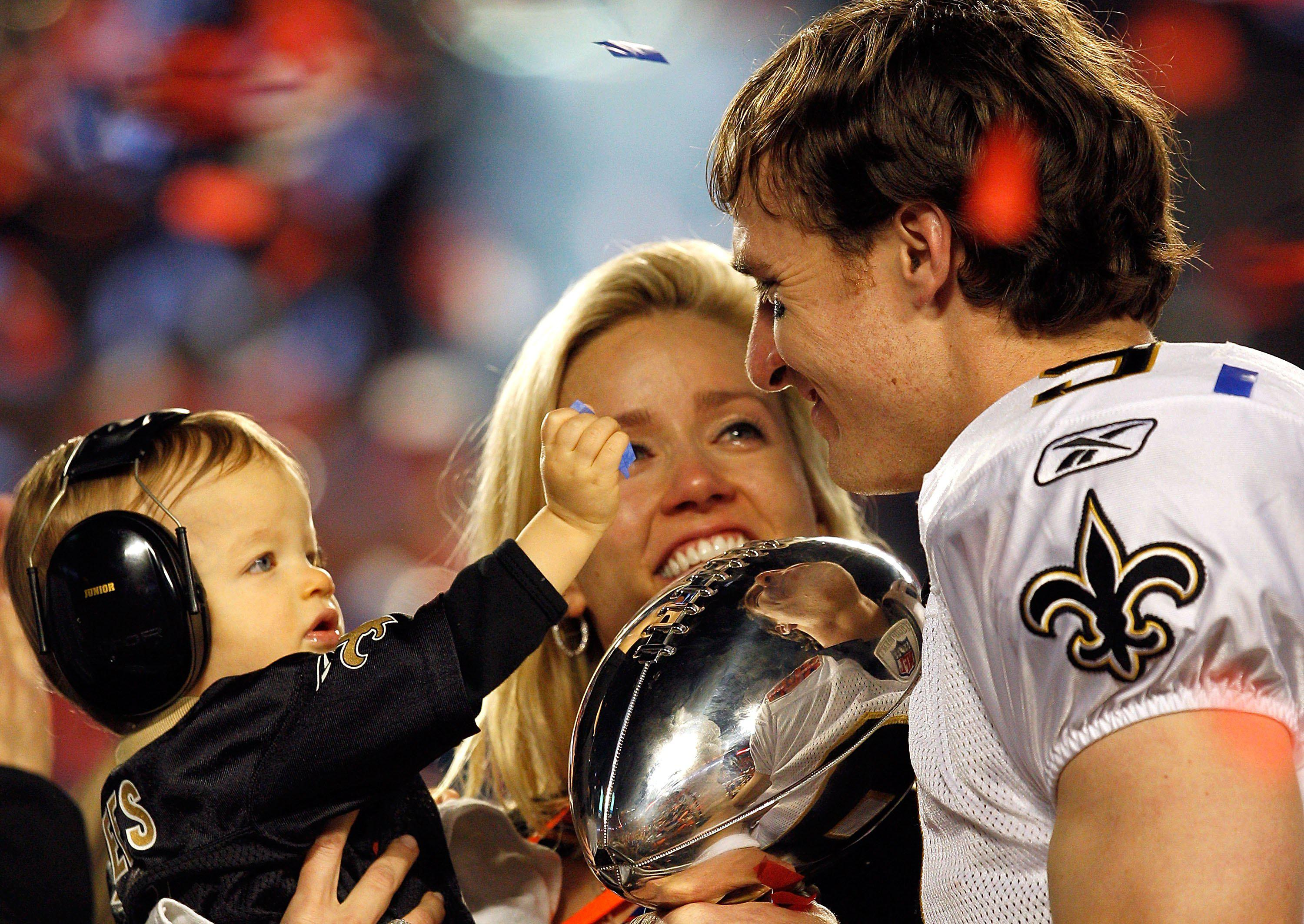 MIAMI GARDENS, FL - FEBRUARY 07:  Drew Brees #9 of the New Orleans Saints celebrates with his son Baylen Brees and wife Brittany Brees after defeating the Indianapolis Colts during Super Bowl XLIV on February 7, 2010 at Sun Life Stadium in Miami Gardens, Florida.  (Photo by Jonathan Daniel/Getty Images)