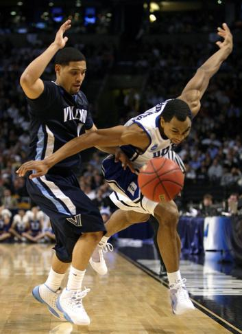 Gerald Henderson #15 of the Duke Blue Devils and Scottie Reynolds #1 of the Villanova Wildcats.