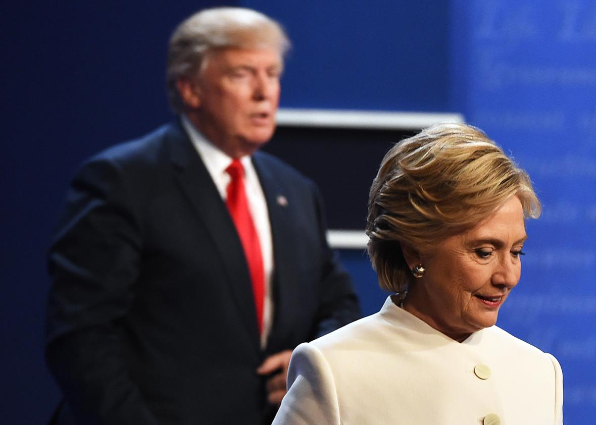 Democratic nominee Hillary Clinton and Republican nominee Donald Trump walk off the stage after the final presidential debate at the Thomas & Mack Center on the campus of the University of Las Vegas in Las Vegas, Nevada on October 19, 2016.