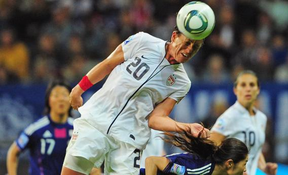Abby Wambach heads the ball during the FIFA Women's Football World Cup final match Japan vs USA on July 17, 2011 in Frankfurt am Main, western Germany.