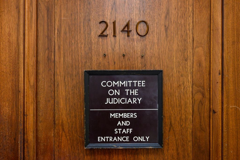 A sign on a closed wooden door reads COMMITTEE ON THE JUDICIARY: MEMBERS AND STAFF ENTRANCE ONLY.