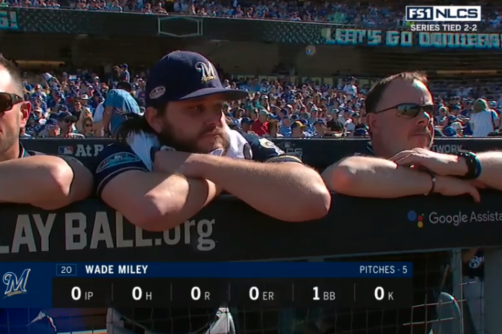 Wade Miley on the steps of the Brewers' dugout after he was removed from Wednesday's game.
