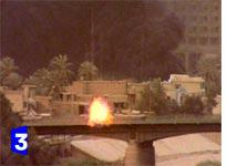 A tank fires toward the Palestine Hotel