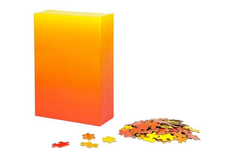 Puzzle box and a pile of puzzle pieces
