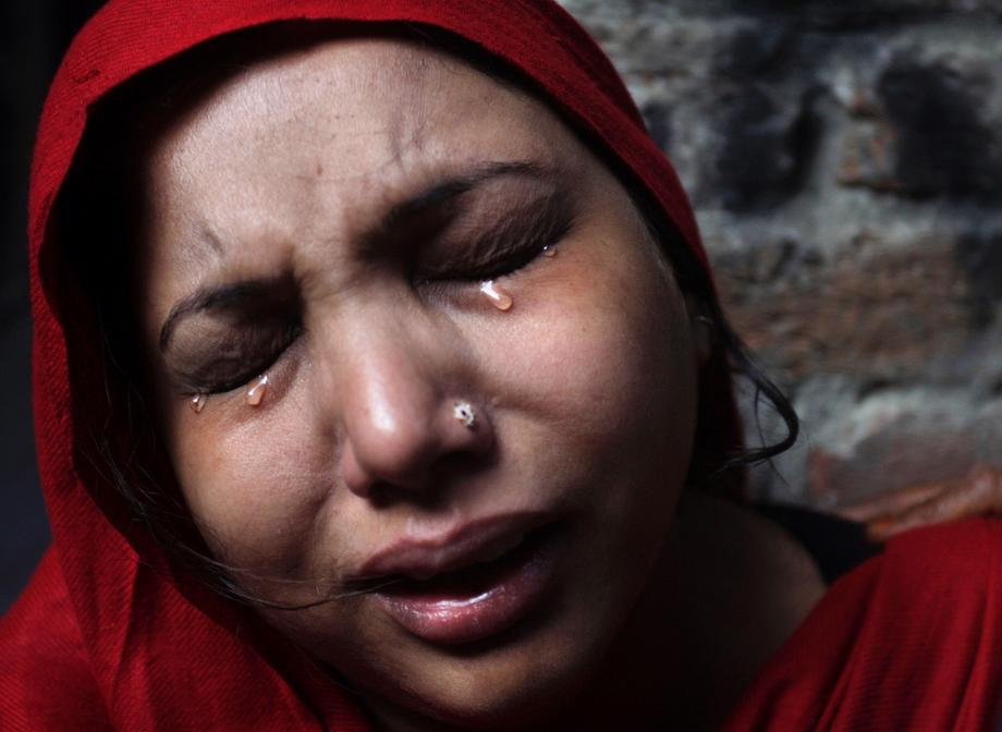 A Pakistani Christian woman weeps after visiting her home, which was damaged by an angry Muslim mob in Lahore, Pakistan, on March 10, 2013. Hundreds of Christians clashed with police in eastern and southern Pakistan on Sunday, a day after a Muslim mob burned dozens of homes owned by members of the minority religious group in retaliation for alleged insults against Islamic Prophet Muhammad.