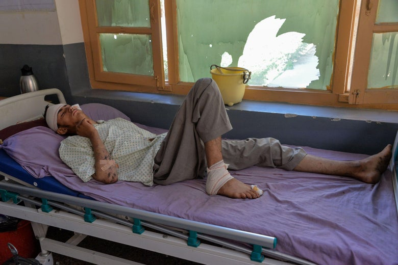 A wounded man lies on a bed as he receives medical treatment at a hospital following a drone strike in Khogyani district of Nangarhar province on September 19, 2019. - At least nine civilians have been killed in a drone strike overnight in the eastern Afghan province of Nangarhar, local officials said on September 19. (Photo by NOORULLAH SHIRZADA / AFP)        (Photo credit should read NOORULLAH SHIRZADA/AFP via Getty Images)