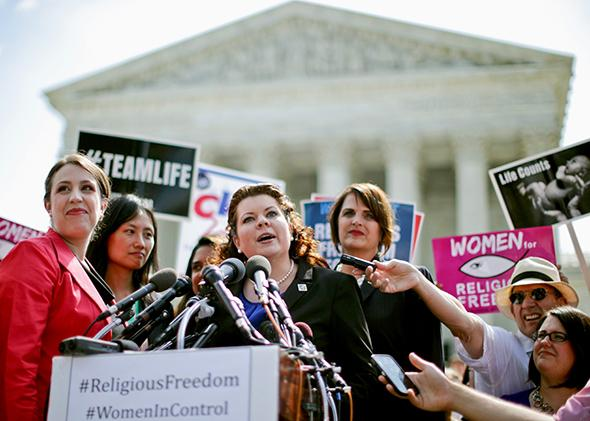 Lori Windham, senior counsel for the Becket Fund for Religious Liberty, addresses the media in front of the Supreme Court after the decision in Burwell v. Hobby Lobby on June 30, 2014.