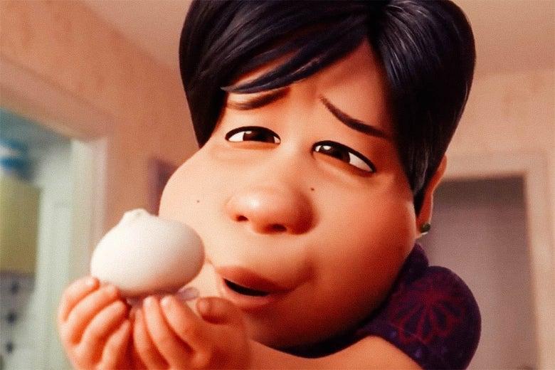 Mother holding a dumpling.