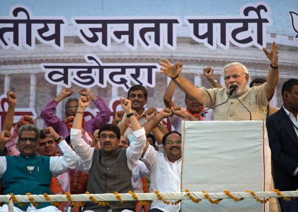 Narendra Modi speaks to supporters after his landslide victory in elections on May 16, 2014, in Vadodara, India.