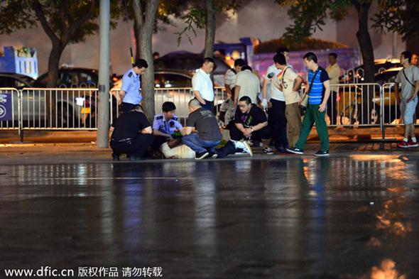 Police officers catch a foreign drug dealer in a campaign in Sanlitun, a popular Beijing bar area, on May 24