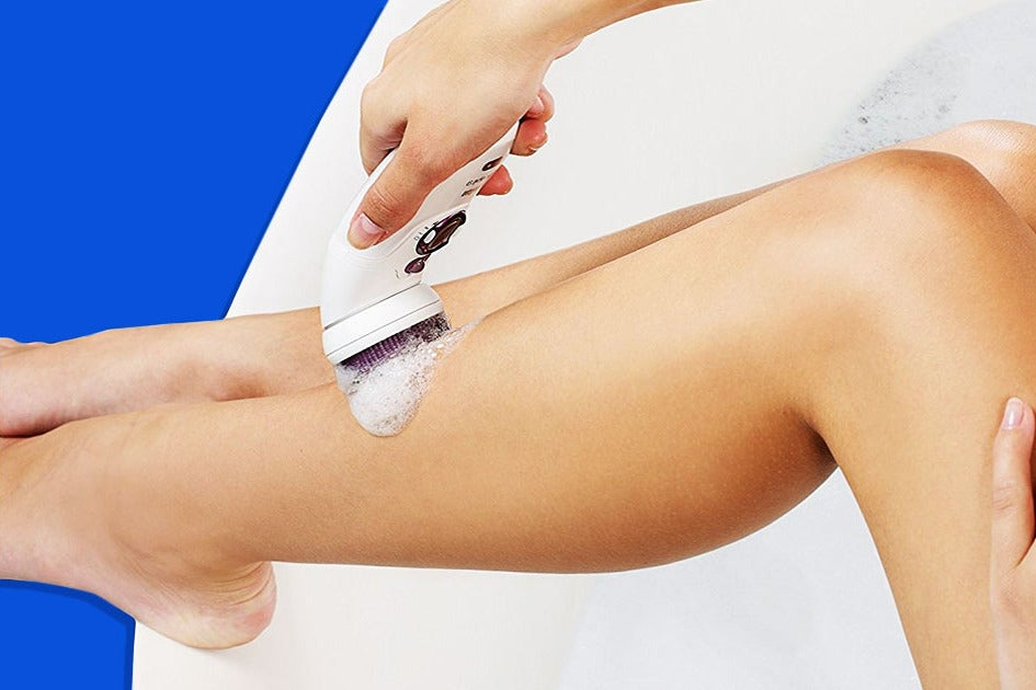 Woman using a Braun Silk-épil 9 Epilator for Women and Bikini Trimmer on her leg.