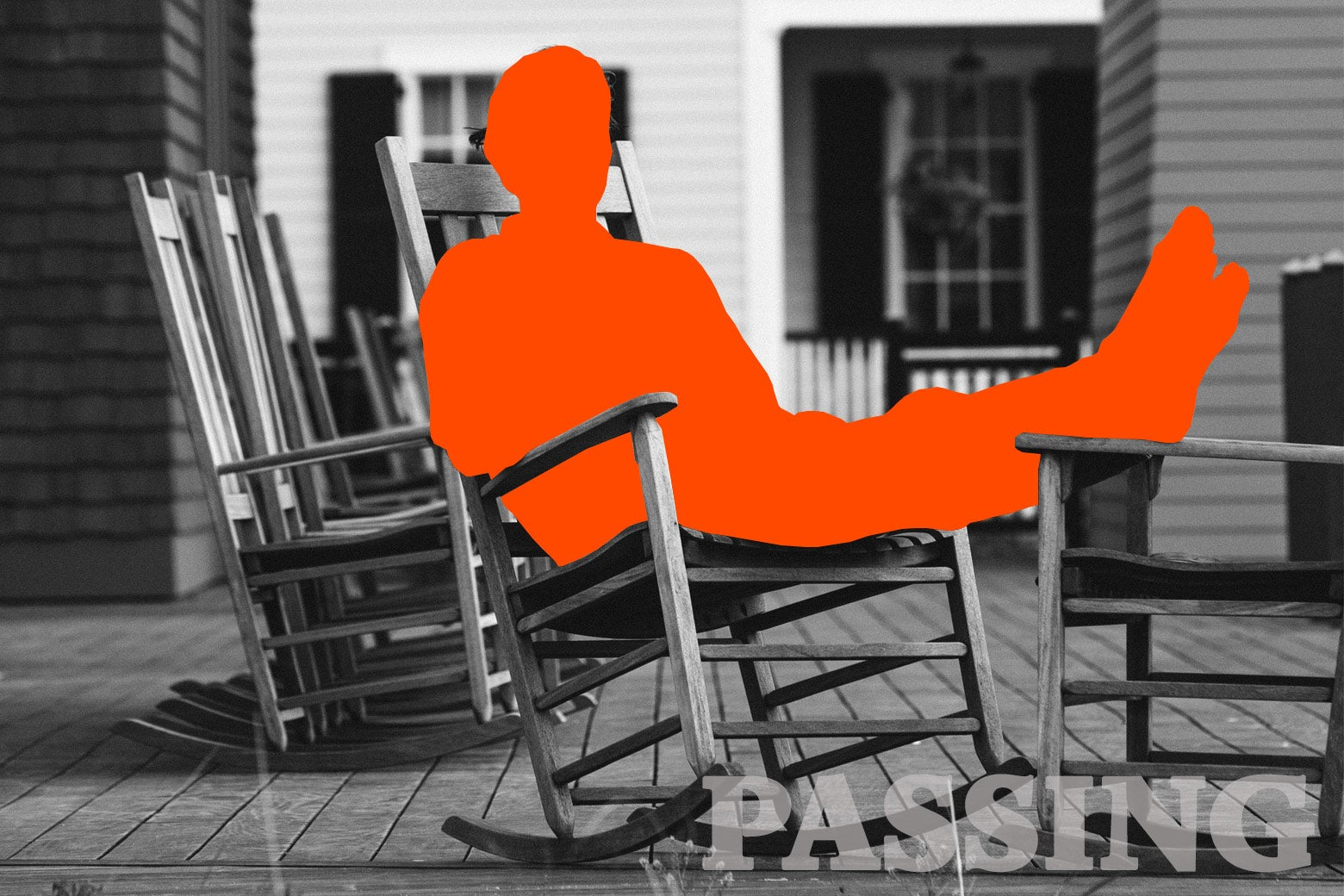 A man sitting on a rocking chair on a porch.