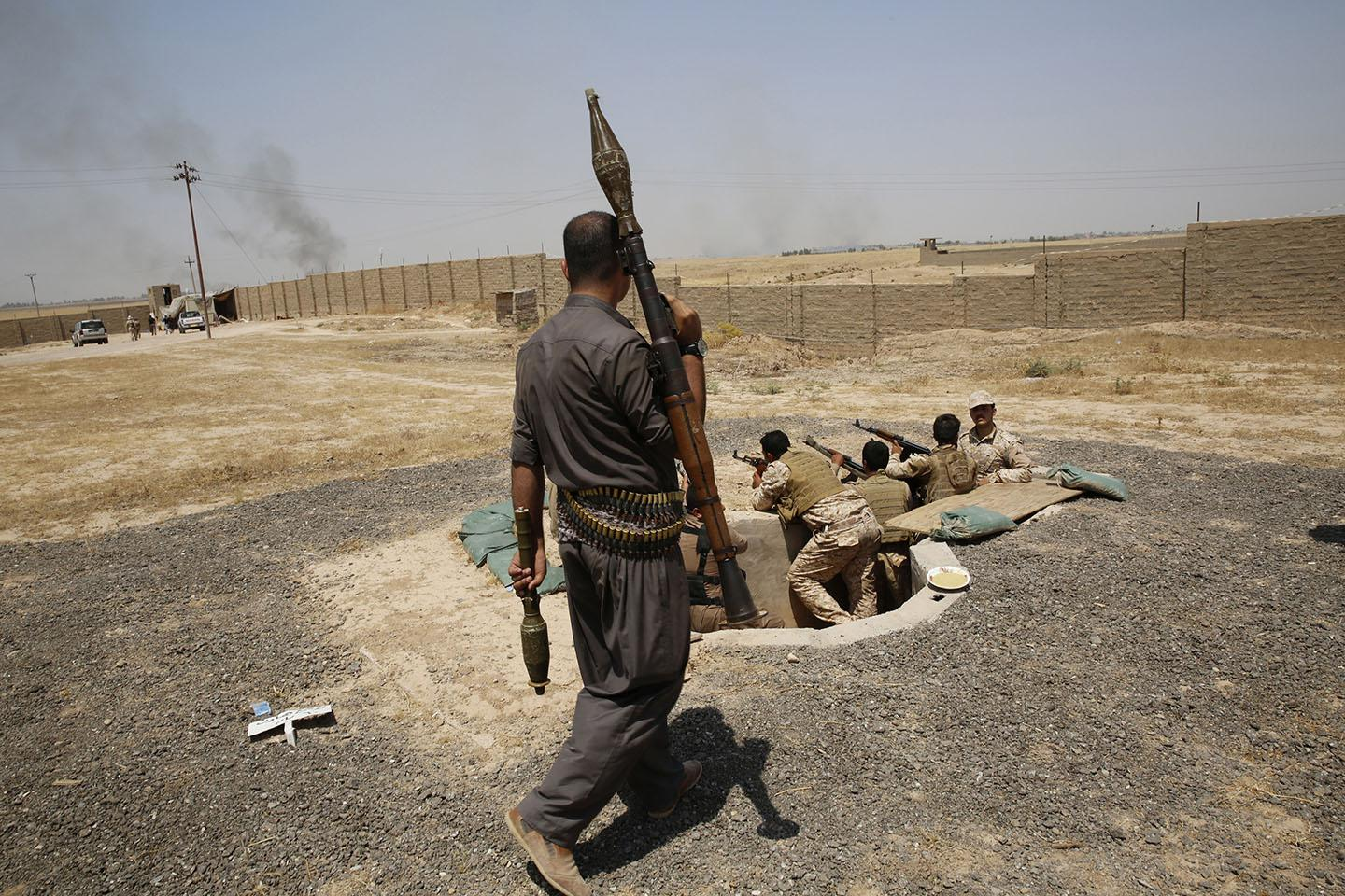 Members of Kurdish security during clashes with ISIS militants in the village of Basheer, south of the city of Kirkuk, June 29, 2014.