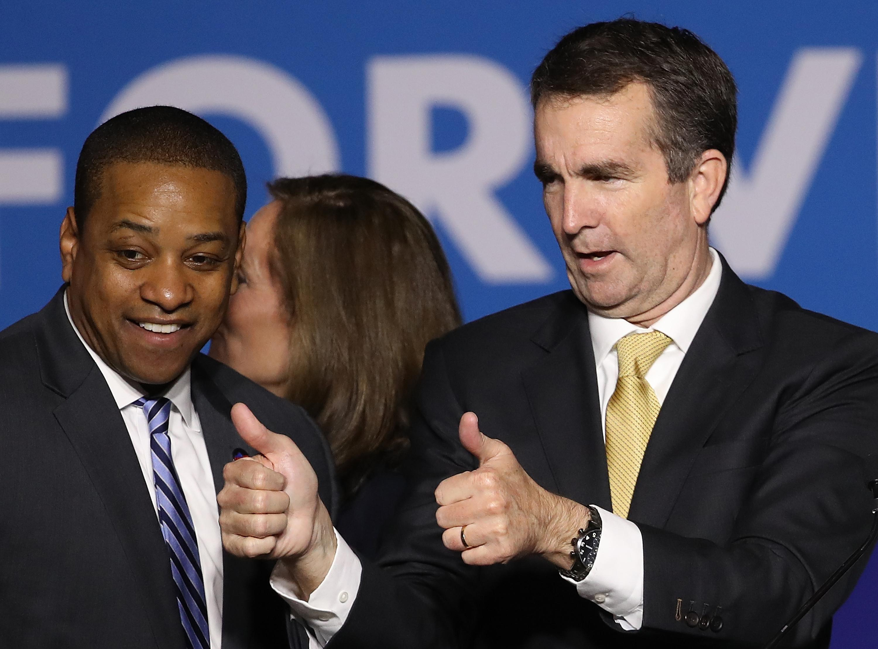 Fairfax smiles and Northam gives a thumbs-up in a campaign night photo.