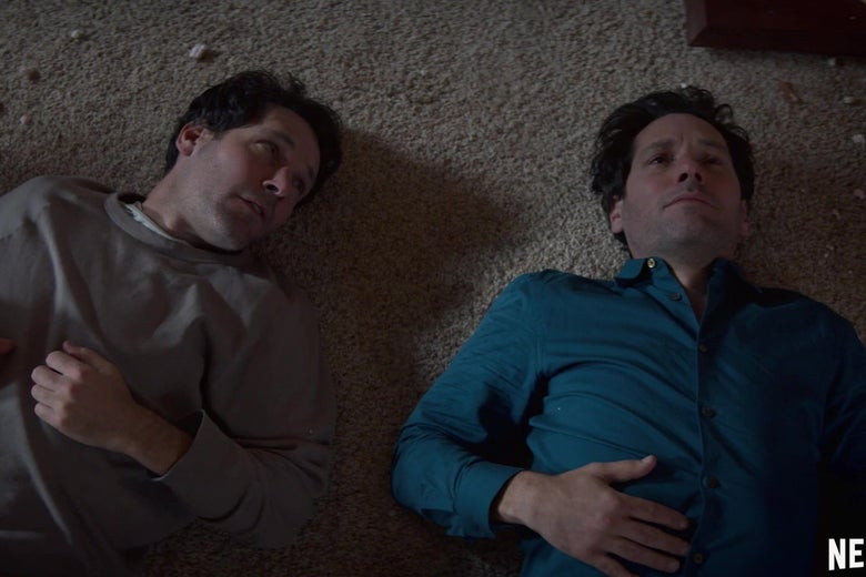 Paul Rudd and Paul Rudd lie on the floor talking to each other.