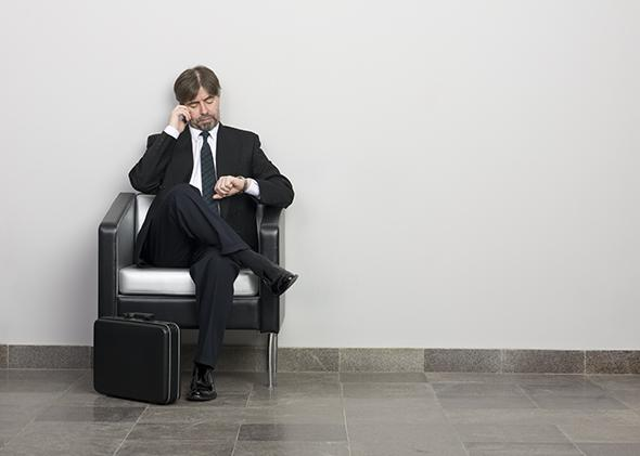 Man with briefcase waiting before a job interview