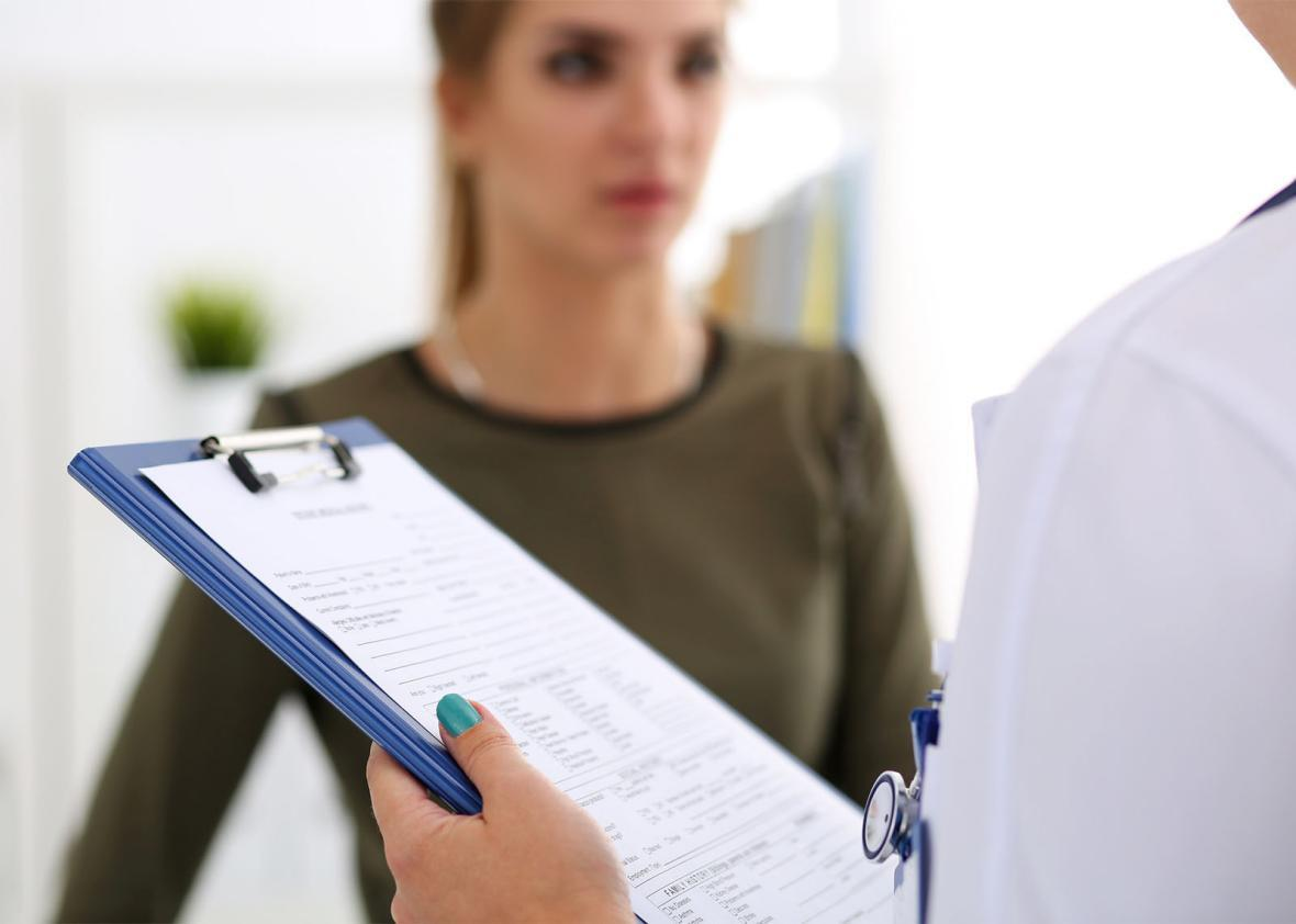 Female patient, doctor with clipboard