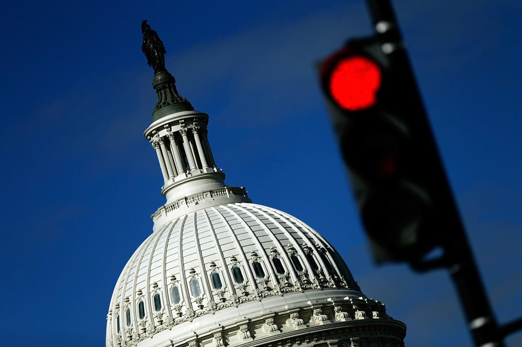 A traffic light is seen in front of the United States Capitol building Sept. 29, 2013