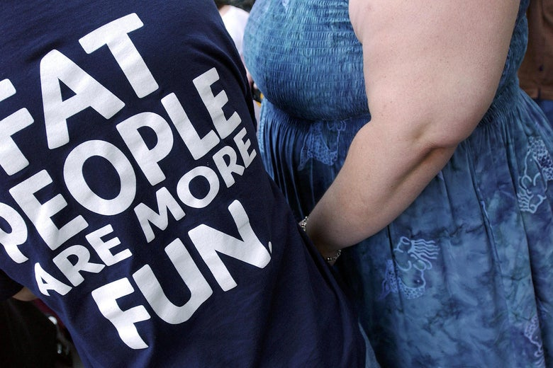 A person wears a 'Fat People are More Fun' tee-shirt during a National Association to Advance Fat Acceptance (NAAFA) rally