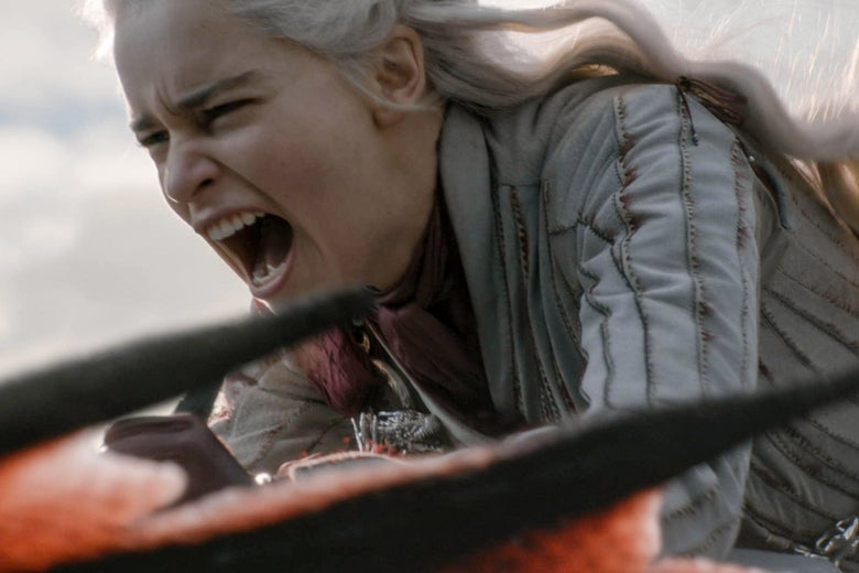 Daenerys Targaryen mid-scream as she rides a dragon.