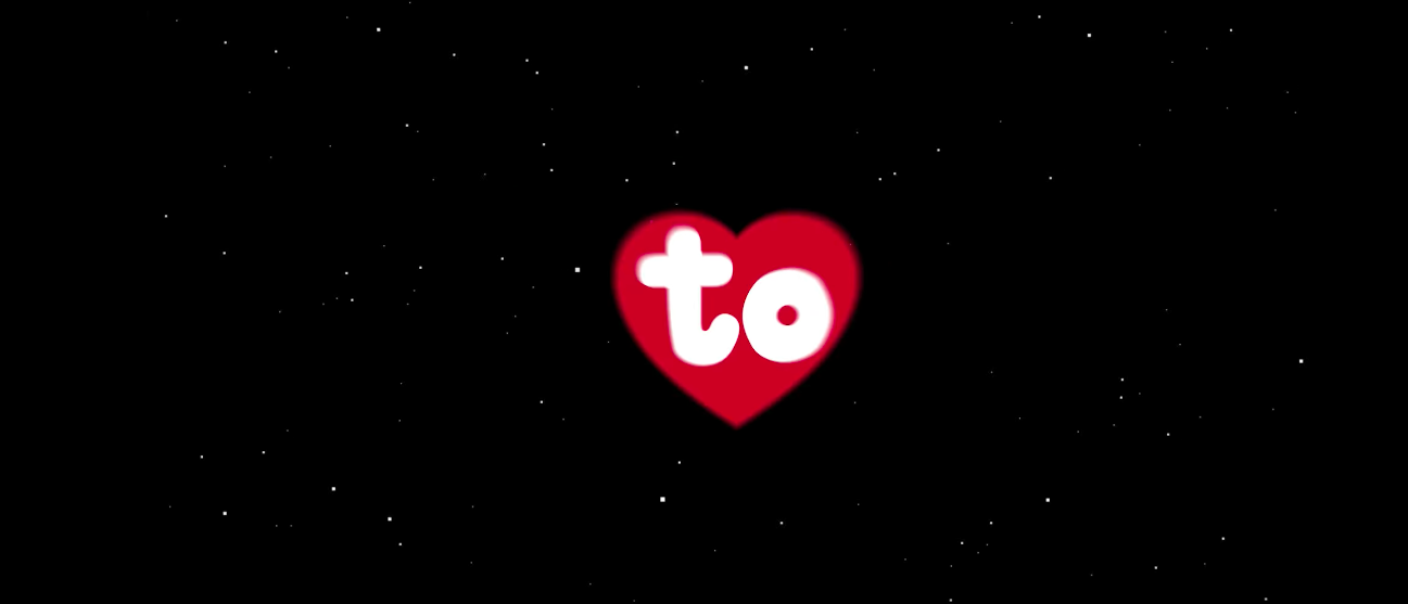"""to"" in red heart in front of a starry background."