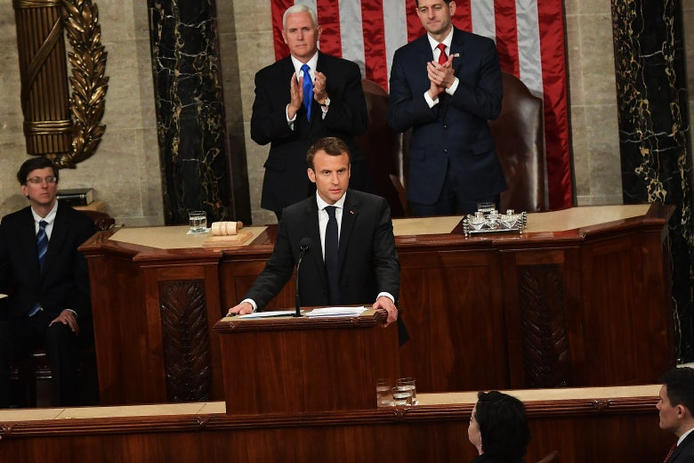 House Speaker Paul Ryan and Vice President Mike Pence applaud after France's President Emmanuel Macron addresses Congress on Wednesday in Washington.