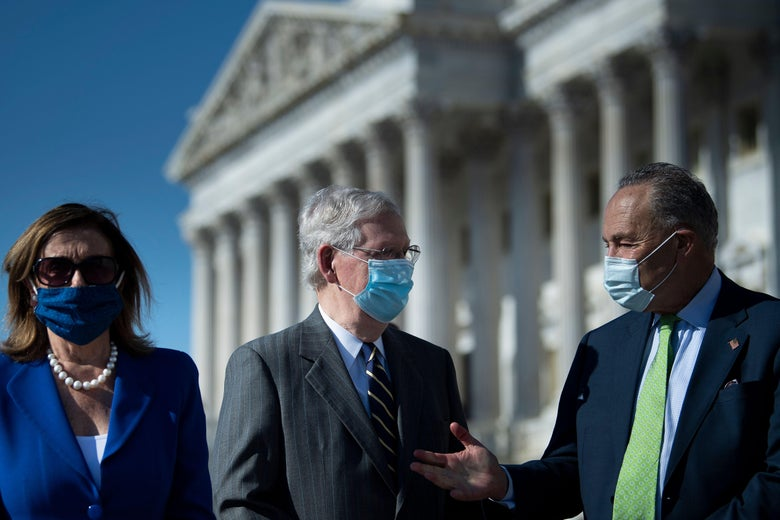 Schumer talks with McConnell outside, while Pelosi looks to the side. All are wearing masks.