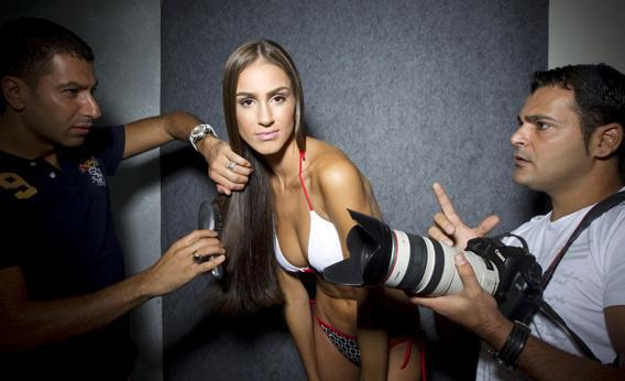 A model is prepared for a photo shoot.
