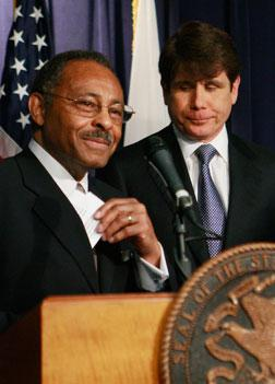 Illinois Gov. Rod Blagojevich (right) and former Illinois Attorney General Roland Burris.