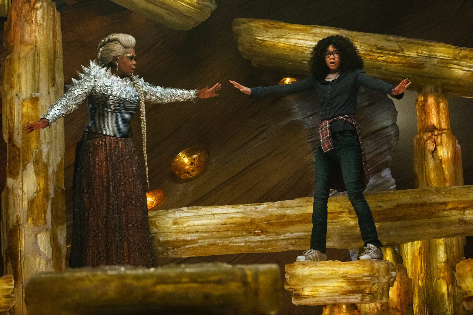 Oprah Winfrey as Mrs. Which and Storm Reid as Meg Murry in Disney's A Wrinkle in Time.