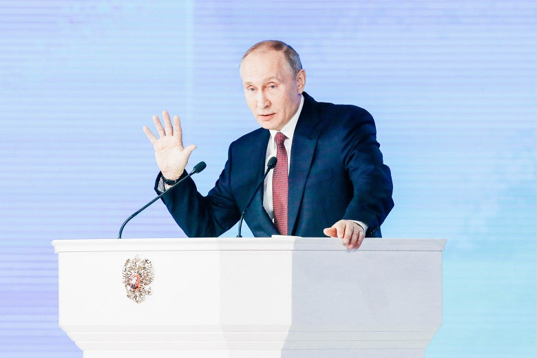 Russia's President Vladimir Putin delivers an annual address to the Federal Assembly of the Russian Federation on Thursday in Moscow.