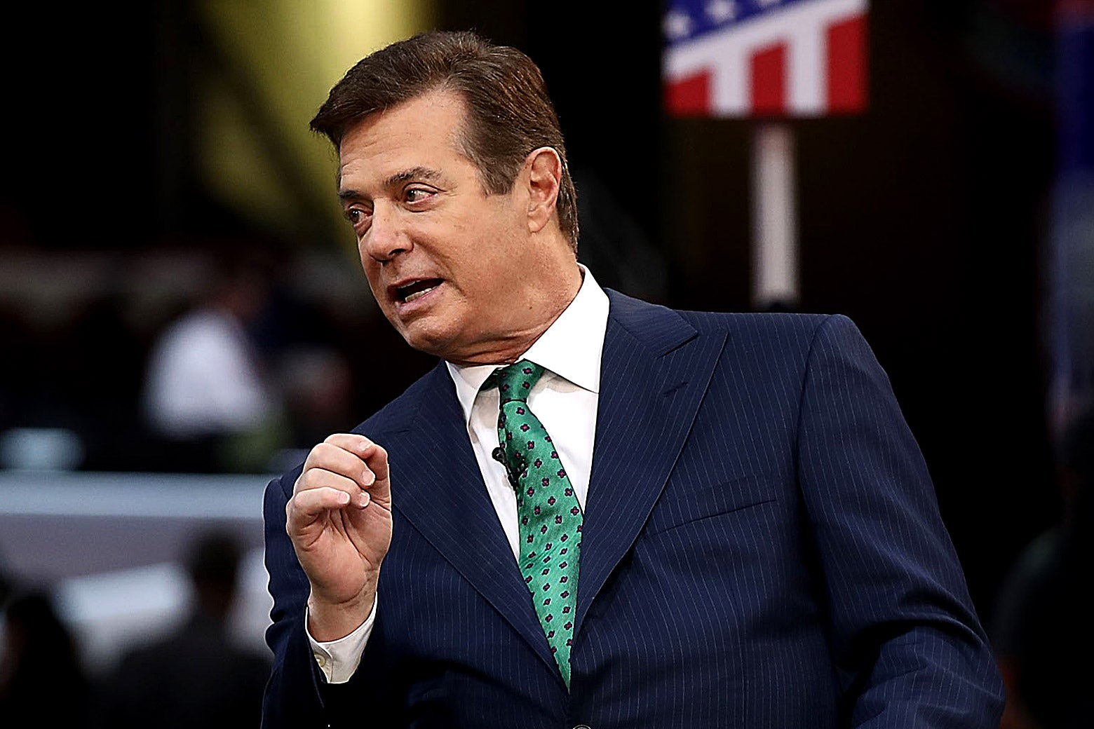 Paul Manafort leans over to talk to an interviewer.