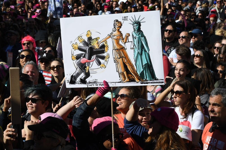 Protesters, part of a 500,000 strong crowd, attend the Women's Rally on the one-year anniversary of the first Women's March in Los Angeles, California on January 20, 2018.         Protestors took to the streets en masse across the United States Saturday, hoisting anti-Donald Trump placards, banging drums and donning pink hats for a second Women's March opposing the president -- one year to the day of his inauguration. Hundreds of thousands of marchers  assembled in Washington, New York, Chicago, Denver, Boston, Los Angeles and other cities nationwide, many donning the famous pink knit 'pussy hats' -- a reference to Trump's videotaped boasts of his license to grope women without repercussions.          / AFP PHOTO / Mark RALSTON        (Photo credit should read MARK RALSTON/AFP/Getty Images)