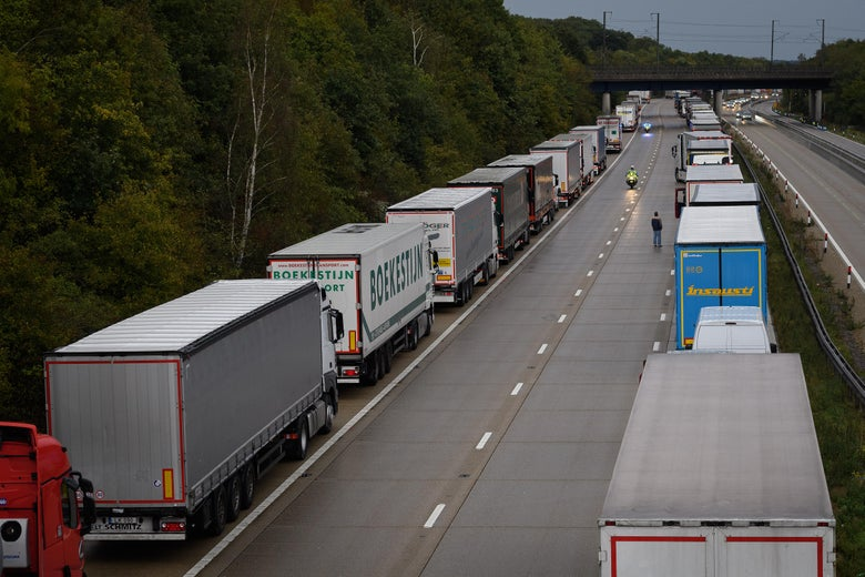 Two backed-up lines of trucks on a highway