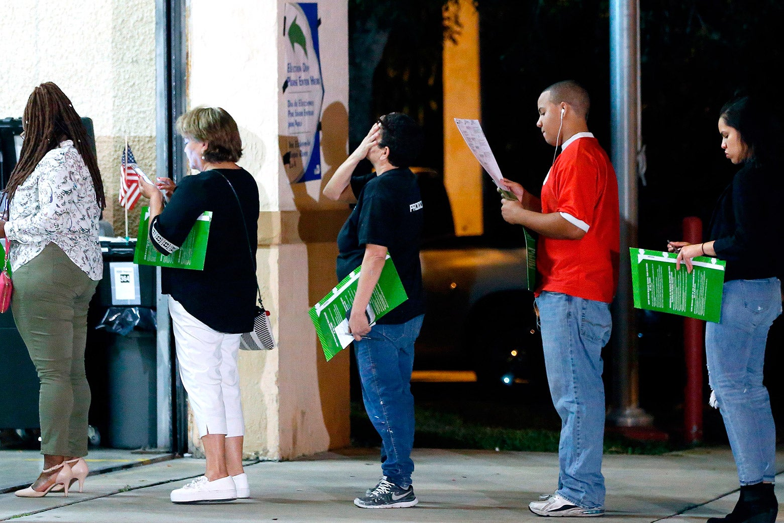 People wait in line to vote at a polling station in Miami, Florida, late on Nov. 6, 2018.