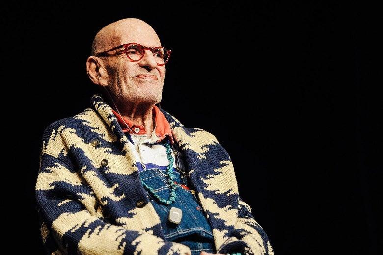 Larry Kramer sits onstage.