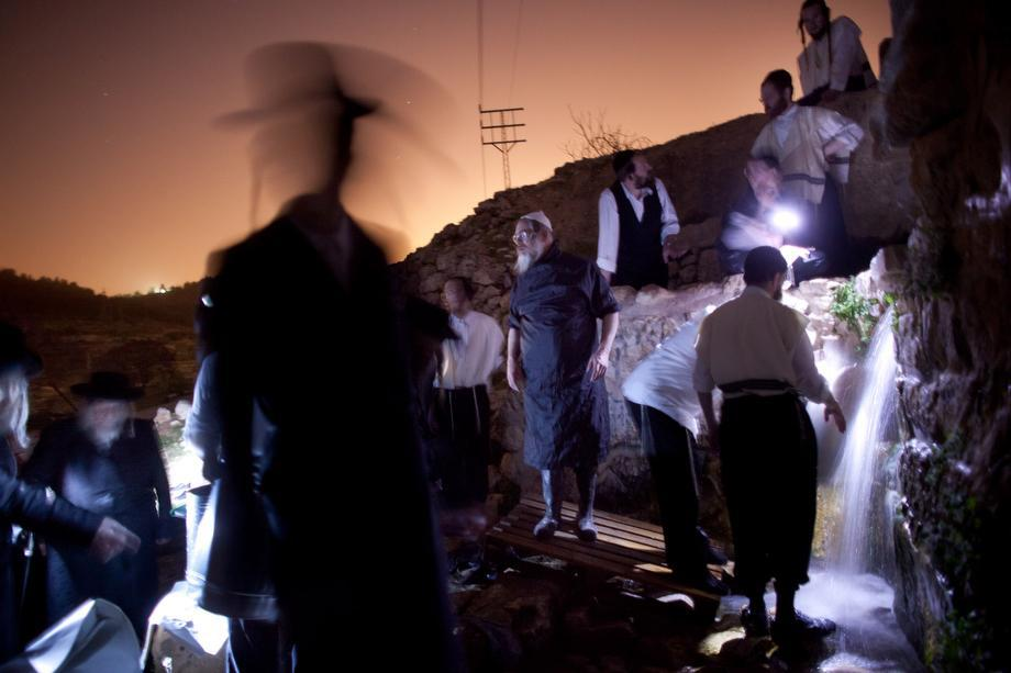 Ultra-Orthodox Jews gather water from a mountain spring to be used to bake the matzo (unleavened bread) during the Maim Shelanu ceremony on March 14, 2013, in Jerusalem. Religious Jews throughout the world eat matzo during the eight-day Passover, or Pesach, holiday, The Jewish holiday commemorates the Israelis' exodus from Egypt some 3,500 years ago and their ancestors' plight by refraining from eating leavened food. Passover begins March 25 and ends on the evening of April 2.
