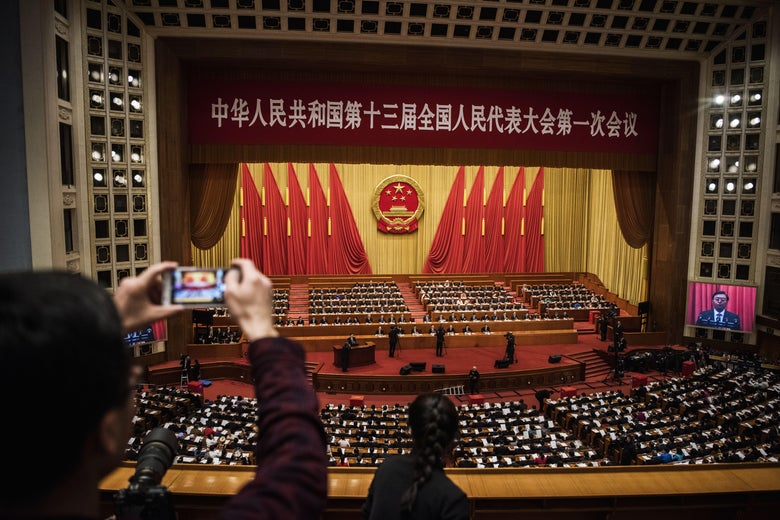 China's President Xi Jinping, (bottom C), joins a session of the National People's Congress to vote on a constitutional amendment at The Great Hall Of The People on March 11, 2018 in Beijing, China.