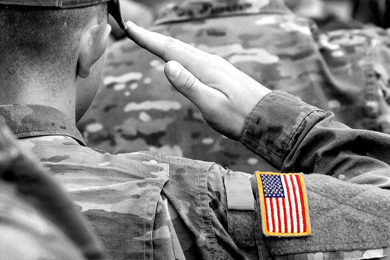 A black-and-white photo of soldiers saluting. The American flag on one soldier's arm is in color.