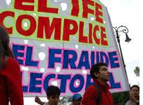 "Students from a local university hold a sign that reads ""IFE: Accomplice in Electoral Fraud""         Click image to expand"